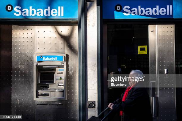 An automated teller machine sits outside a Banco de Sabadell SA bank branch in Barcelona Spain on Saturday March 7 2020 Spanish bank shares soared...