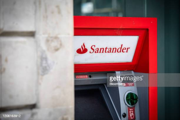 An automated teller machine sits outside a Banco Santander SA bank branch in Barcelona Spain on Friday March 6 2020 Spanish bank shares soared after...