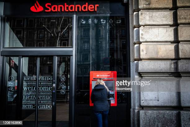 An automated teller machine sits outside the Banco Santander SA Work Cafe coworking space in Barcelona Spain on Friday March 6 2020 Spanish bank...