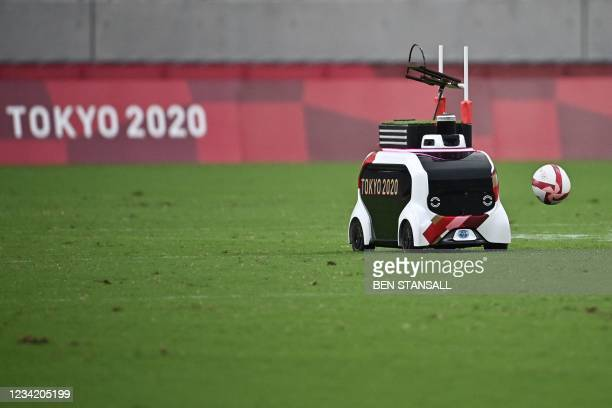 An automated vehicle is used to carry the ball onto the pitch before the men's pool A rugby sevens match between Australia and South Korea during the...