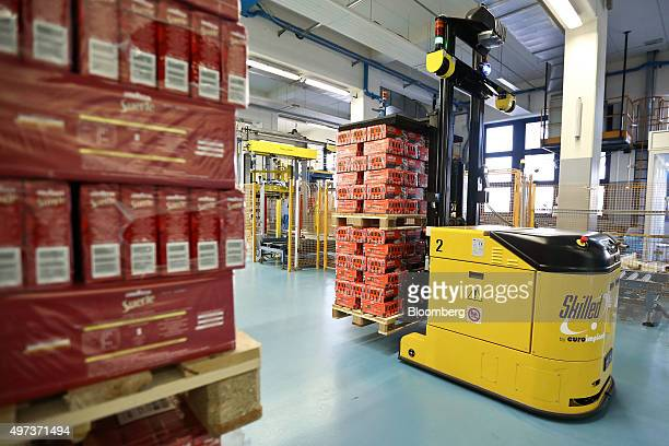An Automatic Guided Vehicle driverless forklift truck made by Skilled by Euroimpianti SpA moves packaged coffee at the Luigi Lavazza SpA coffee...