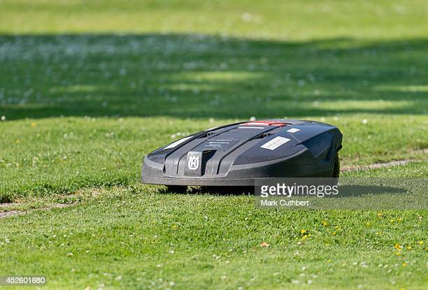 An automatic lawnmower cuts the grass before the annual Summer photo call for the Royal Danish family at Grasten Castle on July 24 2014 in Grasten...