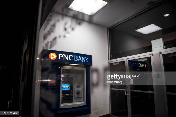 An automatic teller machine stands inside a PNC Financial Services Group Inc bank branch at night in Chicago Illinois US on Tuesday July 10 2018 PNC...