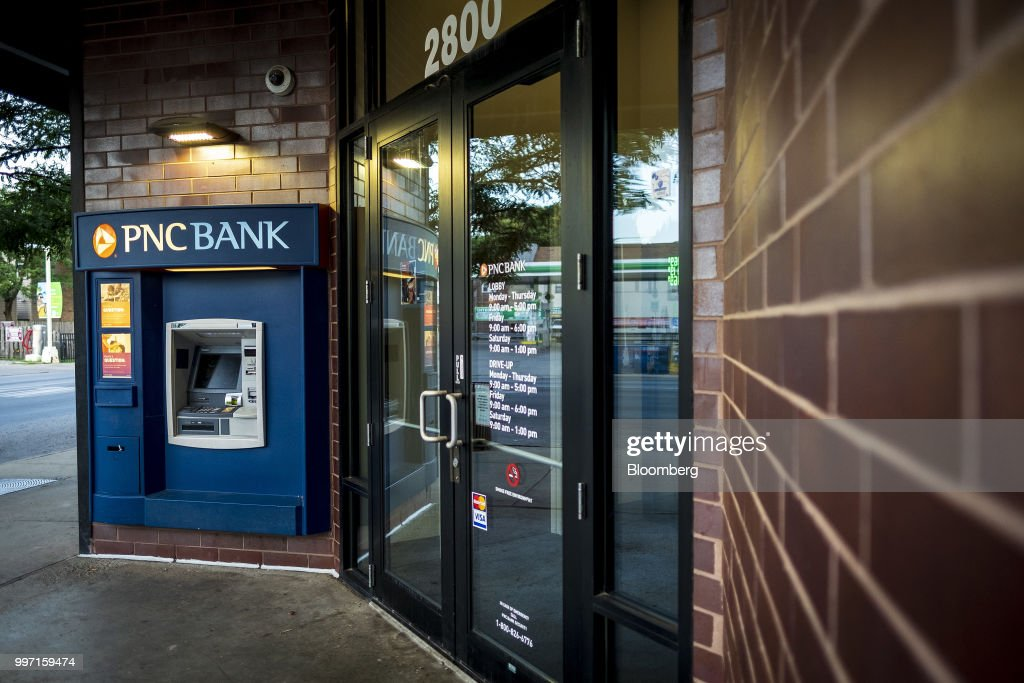 An automatic teller machine (ATM) stands outside a PNC Financial Services Group Inc. bank branch in Chicago, Illinois, U.S., on Thursday, July 12, 2018. PNC Financial Services Group Inc. is scheduled to release earnings figures on July 13. Photographer: Christopher Dilts/Bloomberg via Getty Images
