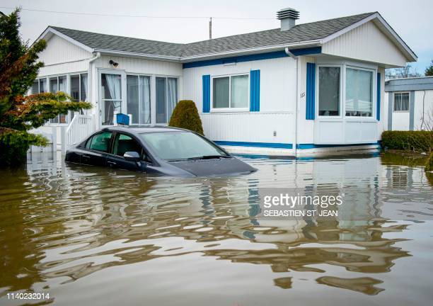 An automobile is submerged in flood waters in the Montreal suburb of SainteMarthesurleLac Quebec Canada April 29 2019 More than 10000 people have...