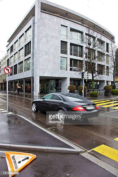 An automobile passes the building that houses the headquarters of Xstrata Plc in Zug, Switzerland, on Monday, March 19, 2012. Glencore International...