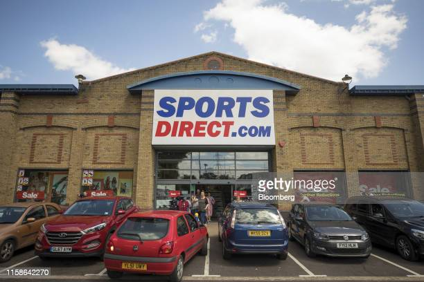 An automobile reverses from a parking space outside a Sports Direct International Plc store in Crayford UK on Monday July 29 2019 Sports Direct...