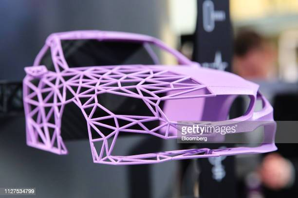 An automobile wireframe model used in a demonstration of augmented reality is displayed on the Ericsson AB stand on day two of the MWC Barcelona in...