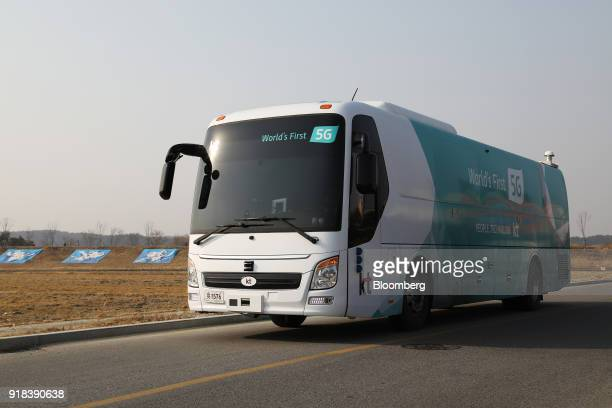 An autonomous 5G connected bus operated by KT Corp travels along a road during a media event in Gangneung Gangwon Province South Korea on Wednesday...