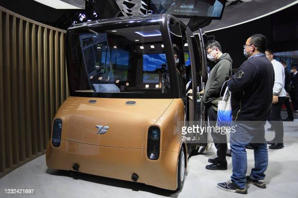 An autonomous driving mini bus at Toyota Boshoku booth on display during the 19th Shanghai International Automobile Industry Exhibition, also known...