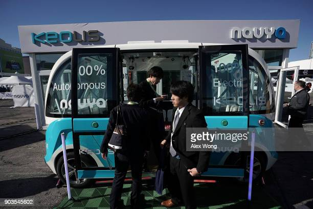 An autonomous electric shuttle bus built by Keolis and Navya is on display during CES 2018 at the Las Vegas Convention Center on January 10 2018 in...