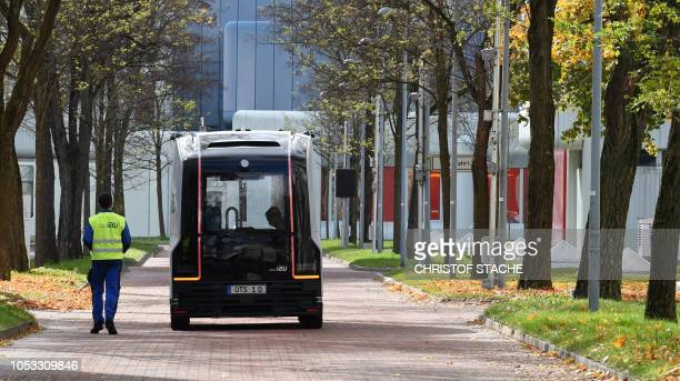 An autonomous electric shuttle bus is drives at the Siemens Campus in Munich Perlach during a first test run on October 25 2018 Siemens Mobility and...