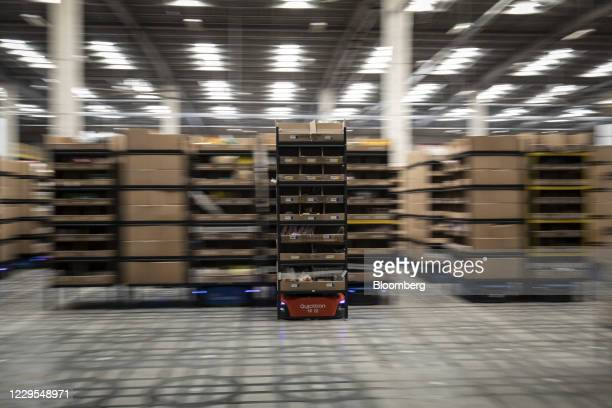 An autonomous logistics robot moves boxes of merchandise to manned order packing stations at a Cainiao warehouse, the logistics subsidiary of Alibaba...