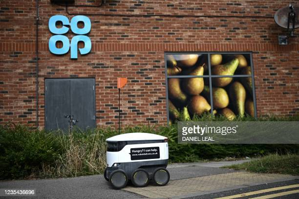 An autonomous robot called Starship is pictured on its way to deliver groceries from a nearby Co-op supermarket in Milton Keynes, England on...