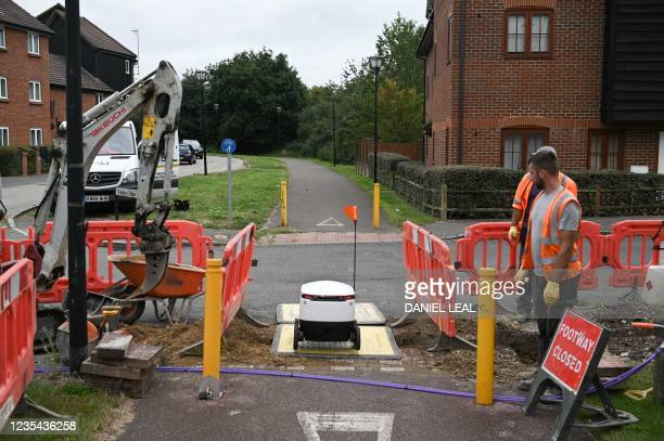 An autonomous robot called Starship travels along a pathway under construction on its way to deliver groceries from a nearby Co-op supermarket in...
