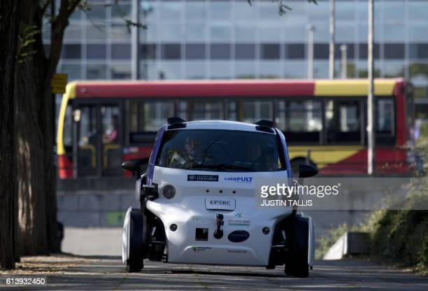 An autonomous self-driving vehicle, as pictured as it is tested in a pedestrianised zone, during a media event in Milton Keynes, north of London, on...