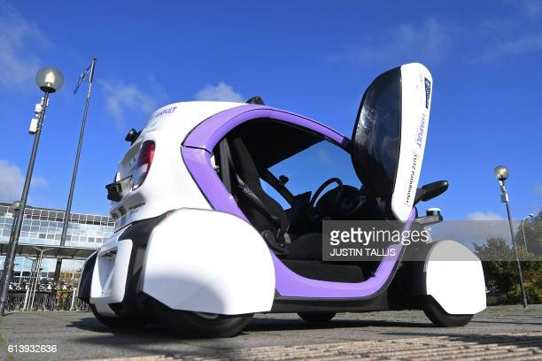 An autonomous selfdriving vehicle is pictured during a media event in Milton Keynes north of London on October 11 2016 Driverless vehicles carrying...