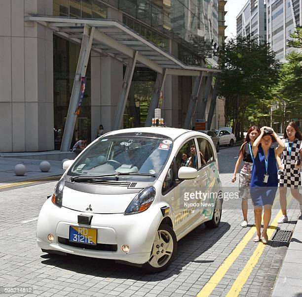 An autonomous taxi carries a passenger during a test drive in Singapore on Aug 25 as the world's first selfdriving taxis operated by nuTonomy an...