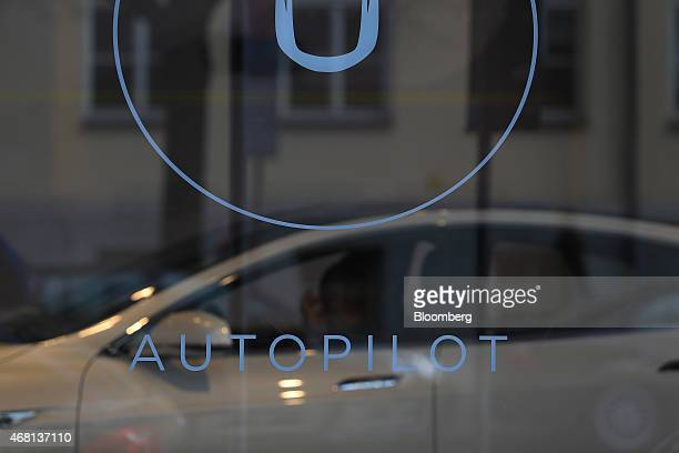 An Autopilot selfdriving sign sits on the window of a Tesla Motors Inc electric automobile store in Munich Germany on Monday March 30 2015 Chief...
