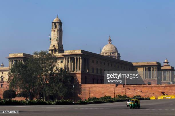 An autorickshaw travels along King's Way boulevard flanked by the South Block of the Central Secretariat buildings which houses the Prime Minister's...