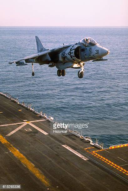 An AV8B Harrier aircraft of marine Heavy Helicopter Squadron 362 takes off from the flight deck of the amphibious assault ship USS Saipan as the...