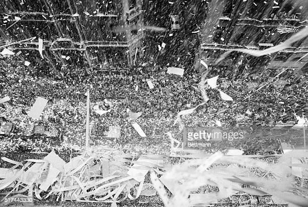 An avalanche of confetti rains down upon a cheering crowd and the three astronauts of the Apollo 11 mission in New York City On July 20th astronauts...