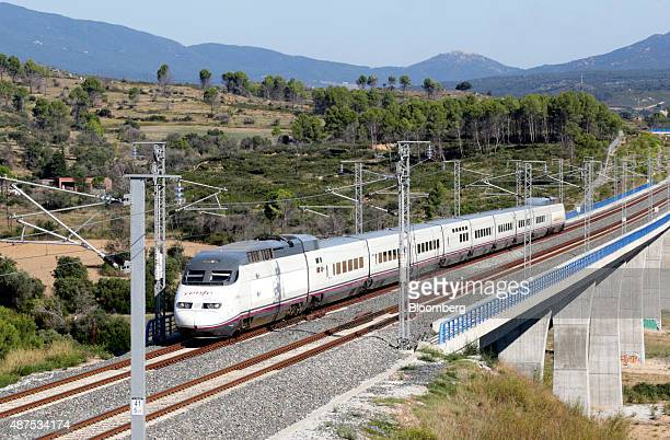 An AVE Class 100 train operated by RENFE Operadora SC passes by the Llobregat river viaduct in Llers Spain on Wednesday Sept 9 2015 TP Ferro...
