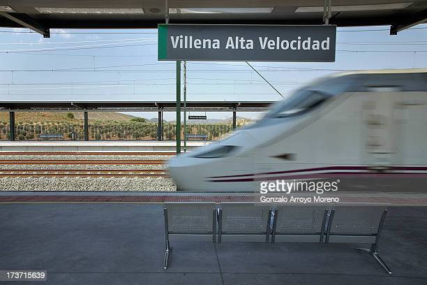 An AVE the Spanish high speed train leaves the Villena station towards Madrid on July 11 2013 in Villena Spain The AVE MadridAlicante highspeed train...