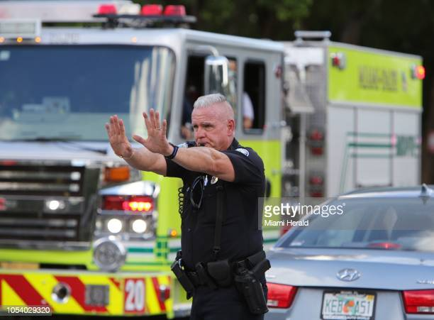 An Aventura Fla police officer directs traffic Firday afternoon Oct 26 around the condo building at 18151 NE 31st Ct where 56 yearold Cesar Sayoc was...
