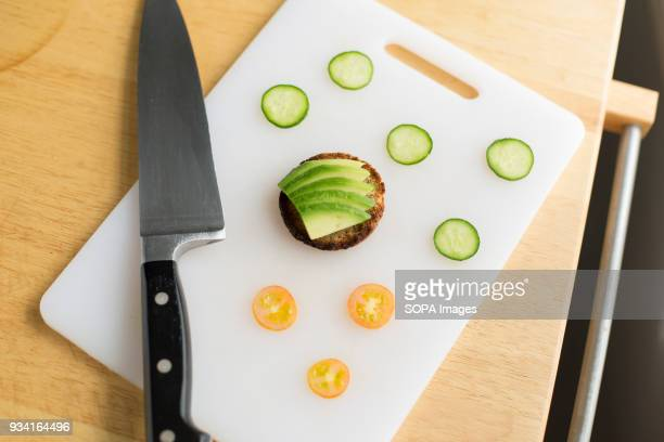 An avocado toast waiting to be decorated with slices of cucumber and tomato