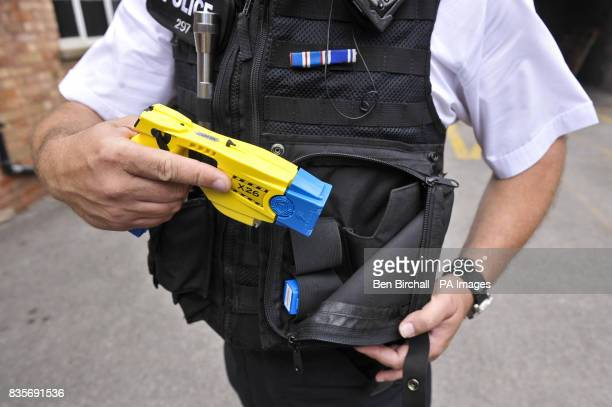 An Avon and Somerset police officer holsters his Taser X26 during a training exercise as Avon and Somerset Constabulary prepare to train another 150...