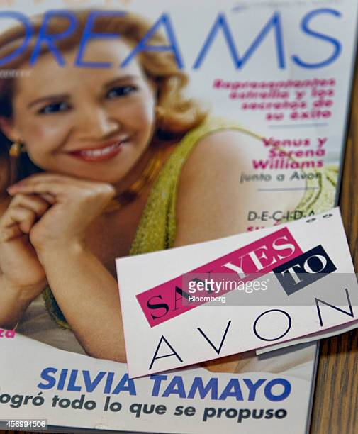An Avon Products Inc business card is arranged for a photograph in McAllen Texas US on Thursday Aug 28 2014 The top 10 US Avon districts are mostly...