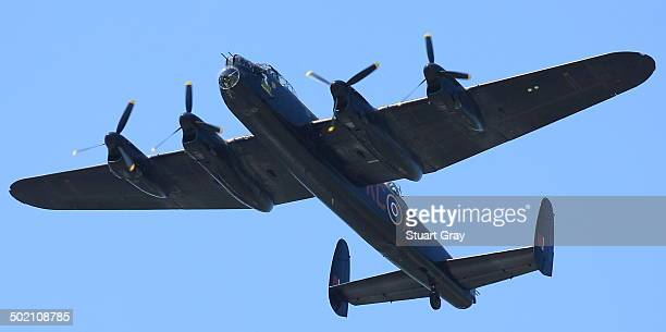 CONTENT] An Avro Lancaster heavy bomber aircraft from the historic Battle of Britain Memorial Flight performs a fly past during an air show
