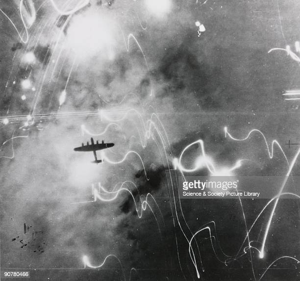 An Avro Lancaster heavy bomber seen from above during a Second World War bombing raid over Hamburg Germany