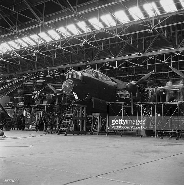 An Avro Lancaster heavy bomber under construction at an Avro factory in Greater Manchester, 16th March 1942. The aircraft entered service with the...