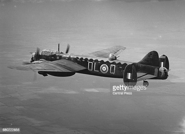 An Avro Manchester Mk1A twinengine heavy bomber L7427 OL Q of No83 Squadron Royal Air Force Bomber Command flying on 21 April 1942 near Scampton...