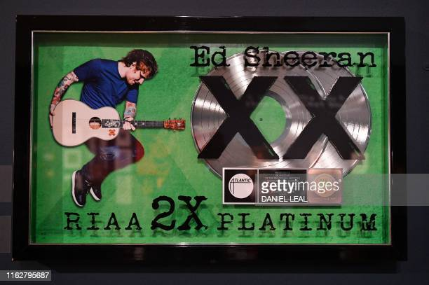 An award for 2x platinum record sales for British musician Ed Sheeran's album 'X' is pictured during a press preview of the exhibition 'Ed Sheeran...