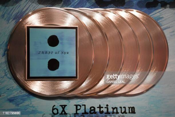 An award for 6x platinum record sales for British musician Ed Sheeran's single 'Shape of You' is pictured during a press preview of the exhibition...