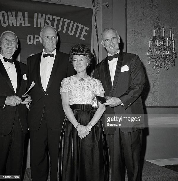 """An awards dinner for the National Institute of Social Sciences Gold Medals, given annually for """"distinguished service to humanity."""" Left to right:..."""