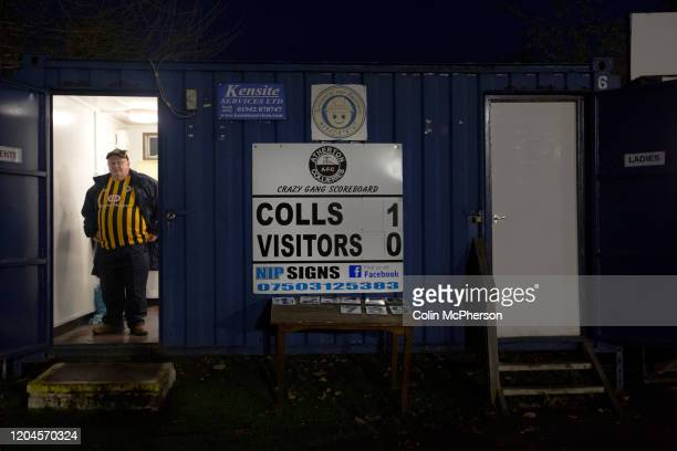 An away supporter pictured next to the scoreboard as Atherton Collieries played Boston United in the FA Trophy third qualifying round at the Skuna...
