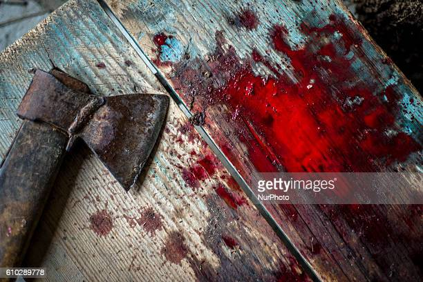 An ax used for cutting meat of sacrificed lamb in a village near Masally Azerbaijan on 12 September 2016