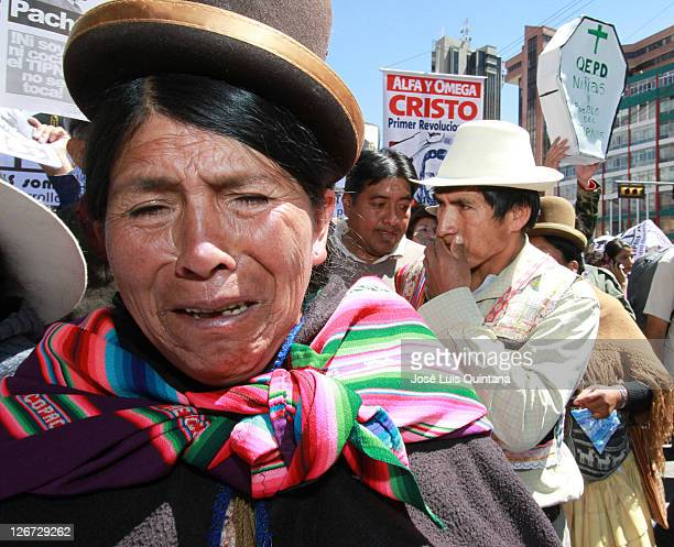 An Aymara indigenous cries during the demonstration of students, workers and teachers of different social organizations who show their disagreement...
