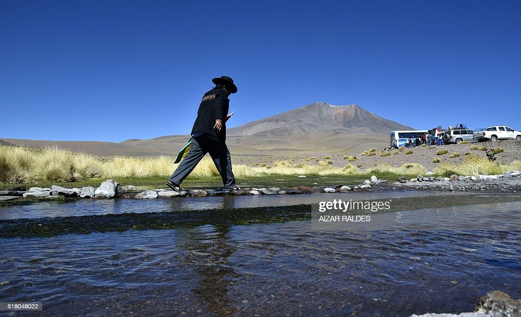 An Aymara indigenous man walks along the Silala springs, in Potosi department, southwestern Bolivia, 4 km away from the border with Chile, on March 29, 2016. The Silala water system is the new dispute between Bolivia and Chile and the International Court of Justice (ICJ) of The Hague declared itself competent in the matter past September.