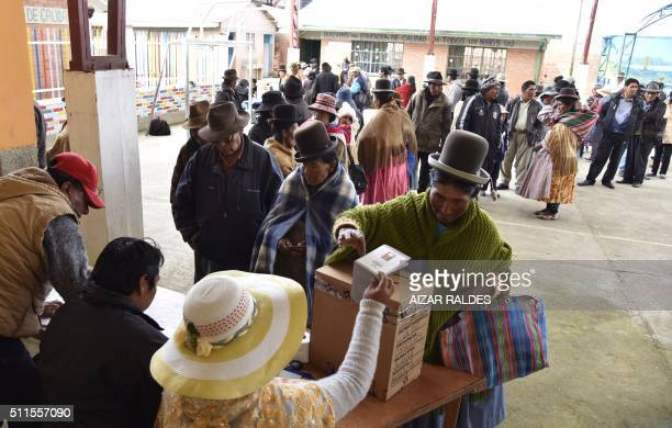 An Aymara indigenous woman places her vote in the ballot box on February 21 2016 in Huarina 75 km from La Paz Bolivia during a referendum on a...