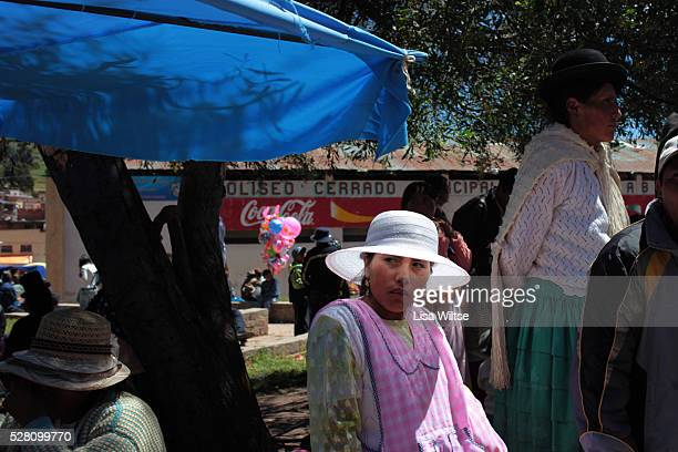 An Aymaran woman selling traditional food during the Fiesta de la Virgen de la Candelaria is held to honour the Virgen or the Dark Virgin of the Lake...