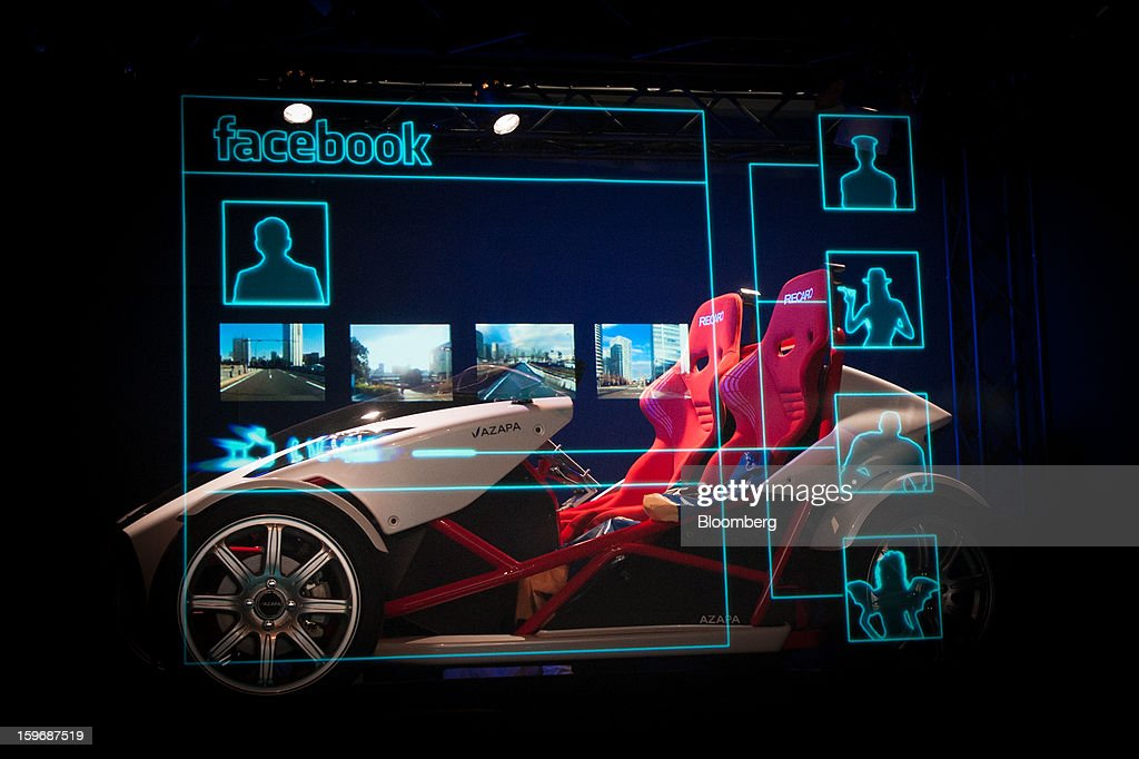 An Azapa Co. AZP-LSEV electric vehicle (EV) is displayed behind a screen simulating a Facebook page during a demonstration at Automotive World 2013 in Tokyo, Japan, on Friday, Jan. 18, 2013. The Automotive World 2013 trade show ends today. Photographer: Noriko Hayashi/Bloomberg via Getty Images