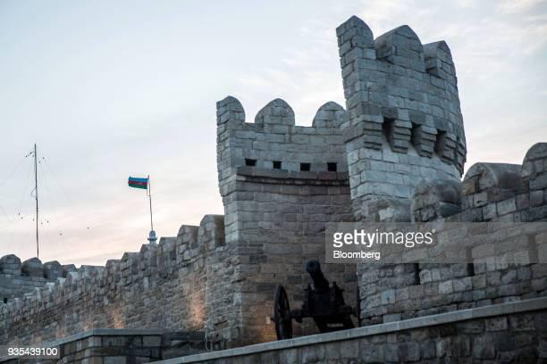 An Azerbaijan flag flies beyond the walls of the Old City of Baku Azerbaijan on Friday March 16 2018 Azerbaijan's economy barely returned to growth...