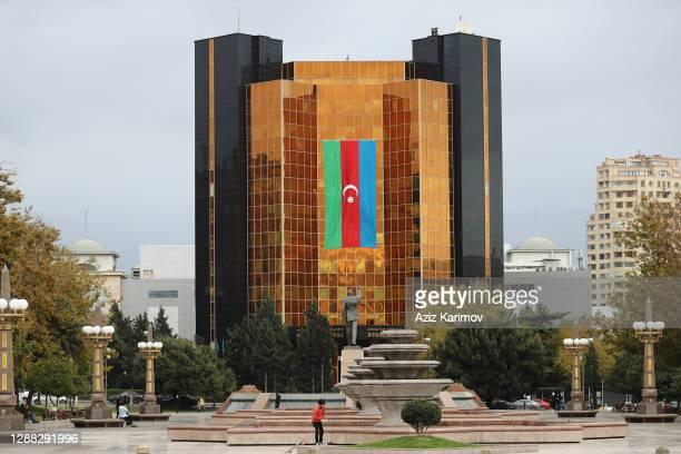 An Azerbaijani flag on the facade of a Azerbaijan National Bank on November 28, 2020 in Baku, Azerbaijan. Flags have been hung up across Azerbaijan...
