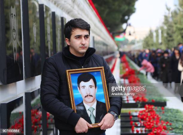 An Azerbaijani visits the Alley of Martyrs a cemetery and memorial dedicated to those killed by Soviet troops during the 1990 Black January crackdown...