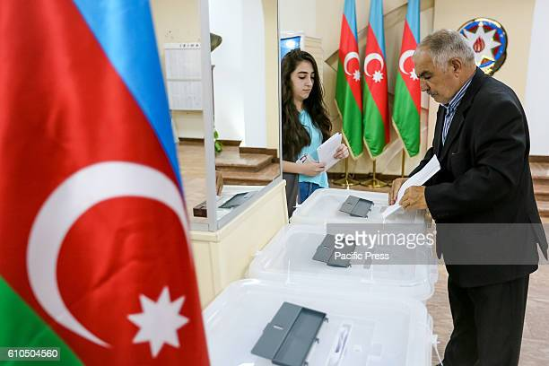 An Azeri man casts his ballot paper during the voting at a polling station in Baku Azerbaijan Today Azerbaijan holds Constitutional Referendum